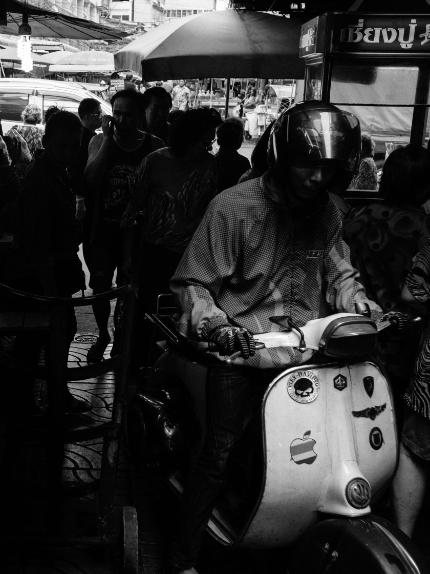 Motorbike entering narrow street in Chinatown, Bangkok